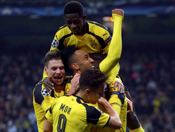 Dortmund stages late comeback to steal 1st place from Real Madrid